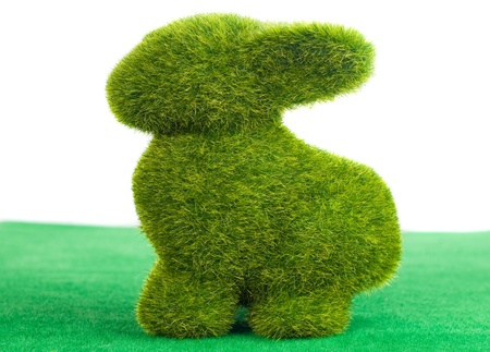 rabbit from artificial green grass isolated on green grass cover and white Stock Photo