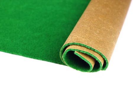 carpet and flooring: roll green grass  isolated on white background  Stock Photo