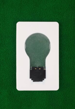 switch of bulb on green grass cover photo