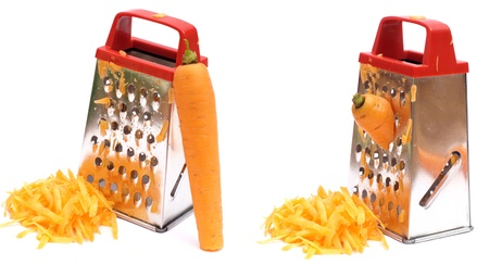 shredding: rub carrots on a grater isolated over white