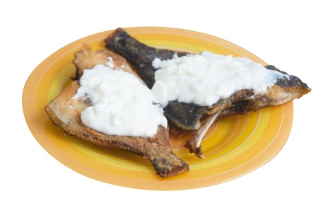 dried flounder with sour cream isolated on hite Stock Photo - 13446689
