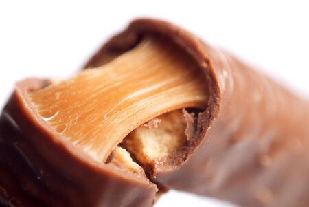 broken caramel chocolate bar  isolated on white Stock Photo - 13446525