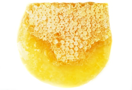 Honey comb: Honeycomb close up on the white