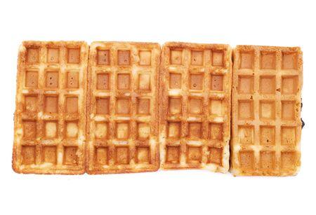 waffles: cuatro gofres belgas con pastila aislado en blanco
