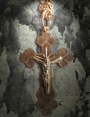 silver cross: cement wall with gold cross Stock Photo