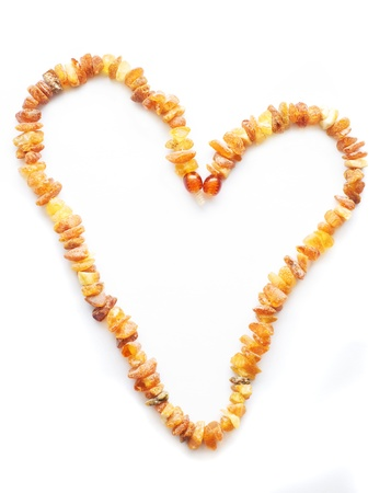 amber: Amber necklace in heart shape Stock Photo