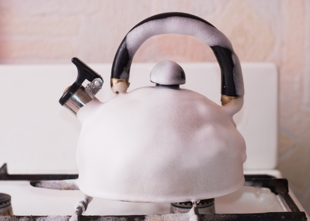 teapot with suds on gas-stove photo
