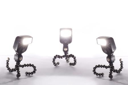 three camera flash isolated on white background Stock Photo - 16332752