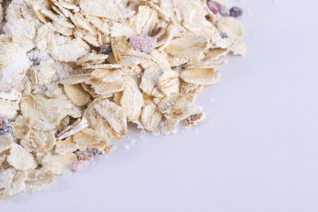 millet: fruit oat flakes isolated on white background Stock Photo