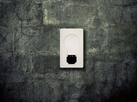 old light switch on a grunge wall  photo