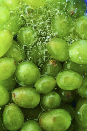 hedonism: Grapes texture with water of close up