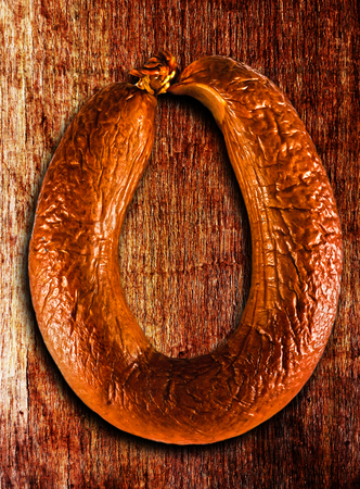 comestible: smoked  sausage isolated on a white background