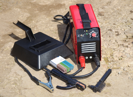blowpipe:  red and black welding apparatus with electrodes and mask Stock Photo
