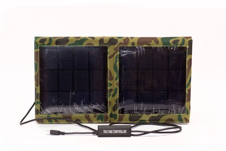 portable Solar charger for mobile phones and notebook isolated on white background photo