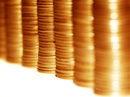 Column of golden coins isolated on white  photo