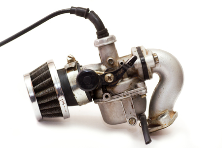 carburettor: old carburettor isolated on white