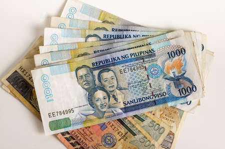 Philippine Currency on a white background photo