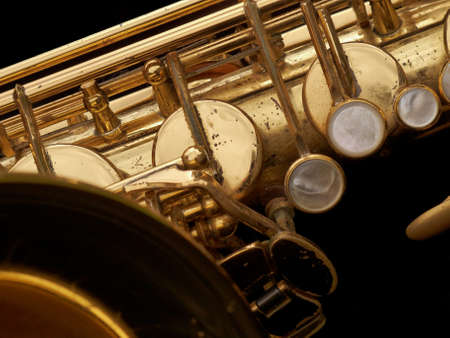 the tenor:      Close up of a well used tenor saxophone