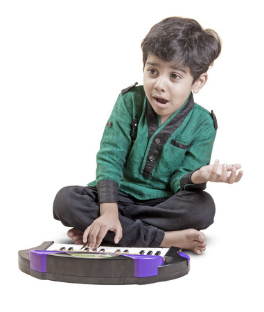 little boy and the keyboard on white background and singing  with path photo