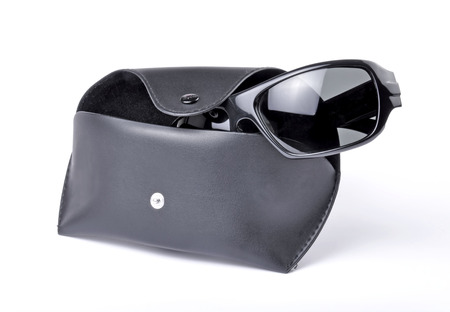 Sunglasses and carri case isolated against a white background photo