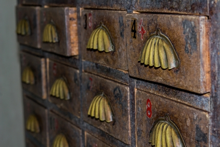 custom cabinet: The drawers contained fortune teller bills ordered by numbers.