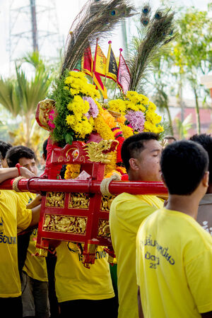 palanquin: Many people are celebrate chinese gods by carry the palanquin to cross over a river an step into fire on February 14, 2014 in Pattani, Thailand. Editorial