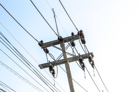 untidy: Untidy electricity lines over the road in Thailand.