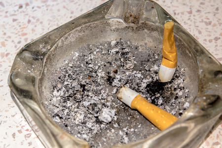residue: Ashes in an ashtray with cigarette residue. Stock Photo