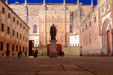 Courtyard of major schools, with the statue of Fray Luis de Leon and the façade of the old University of Salamanca, at night