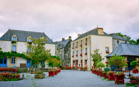Street and colourful ancient houses in Rochefort-en-Terre, French Brittany