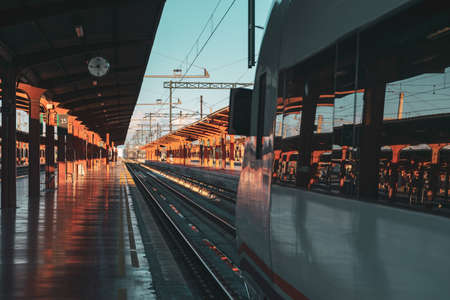 Travel by train concept. Empty station with train ready to leave. Sunset Autumn Light. Madrid, Spain.