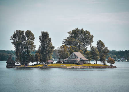 Autumn landscape in the 1000 islands. Houses, boats and islands. Lake Ontario, Canada USA