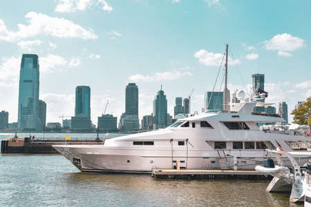 New Jersey skyline from Battery Park in a sunny day. Luxury yacht in the foreground. City, travel and luxury concept. Manhattan, New York City, USA.
