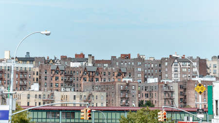 Panoramic roof view of old houses. Brick buildings with fire stairs during the day. Travel and housing concepts. Bronx, NYC, USA.