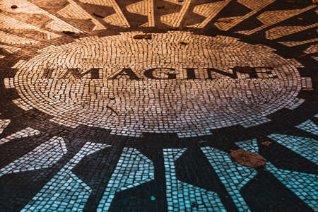 NEW YORK CITY, USA - 2017 SEPTEMBER 7, The caption Imagine on the The Beatles memorial mosaic, in Strawberry Fields (Central Park) in a beautiful sunset light in autumn.