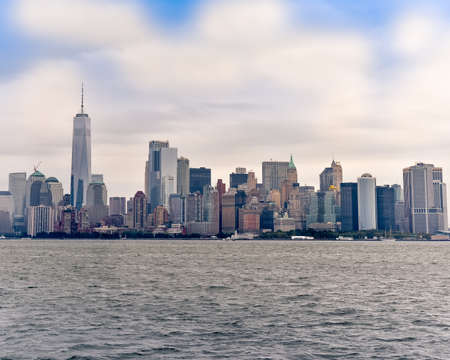 Cityscape of the financial district of Manhattan from Liberty Island, in a sunny day.