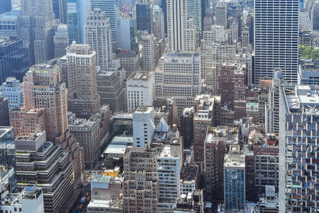 Aerial close up view of crowded buildings in New York City on a sunny day. Construction concept, crowded cities, and apartment rentals. NYC, USA. Stockfoto - 135066942