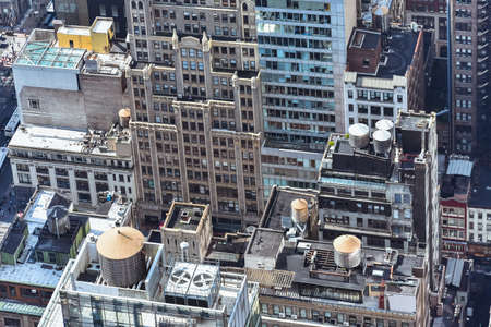 Aerial close up view of crowded buildings in New York City on a sunny day. Construction concept, crowded cities, and apartment rentals. NYC, USA. Stockfoto - 135066917