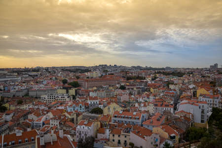 Lisbon panoramic view. Colorful walls of the buildings of Lisbon, with orange roofs , at sunset. Travel and real estate concept. Lisbon, Portugal. Europe. Stockfoto