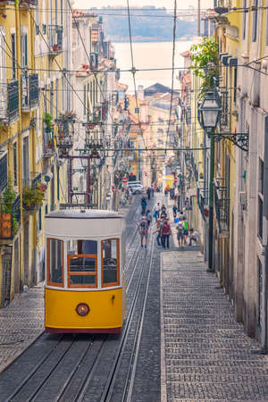 The Bica Funicular (Elevador or Ascensor da Bica) is a famous tourist attraction in Chiado District. Sunny day in summer. Travel and transport concept. Lisbon, Portugal. Europe.