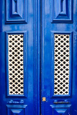 Colorful wood blue door of the Alfama neighborhood. Lisbon, Portugal. Europe. Stock fotó
