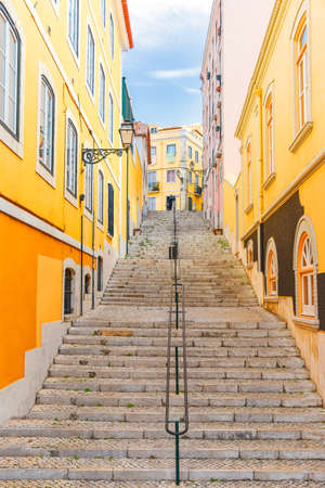 Stairs of the colorful street Travessa da Arrochela on a sunny day in summer. Travel concept. Lisbon, Portugal. Europe.