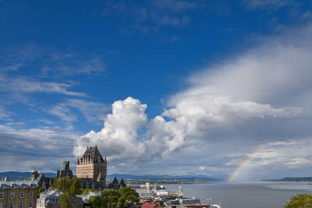 Cityscape of Quebec and St. Lawrence River, On a cloudy sunny day, with rainbow in the background. Concept of travel.