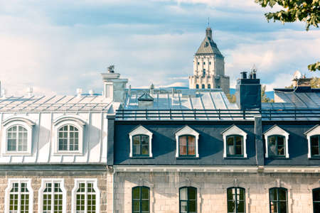 Attic windows of buildings in Quebec, Canada, on a sunny day. Real estate concept. Reklamní fotografie