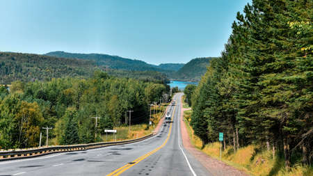 Road between forests and lakes of the Canadian state of Quebec. Stock fotó