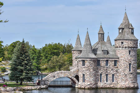 Detail of Boldt castle towers and bridge, in Heart Island. Located in the border between Canada and United States. During daytime in a blue sky. Thousands Islands. Ontario, Canada.