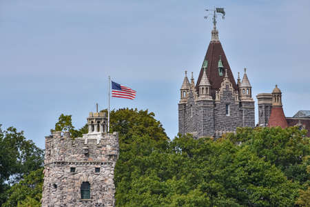 Detail of Boldt castle towers in Heart Island. Located in the border between Canada and United States. An United States flag on the top. Thousands Islands. Ontario, Canada.