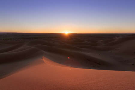 Huge desert dunes of Erg Chigaga, at the gates of the Sahara, at sunset. Morocco. Concept of travel and adventure.