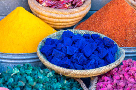 Detail of colorful spices in the markets of the medina of Marrakech, Morocco.