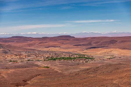 Daytime wide angle shoot of a town and the Atlas Mountains in the background, Morocco.